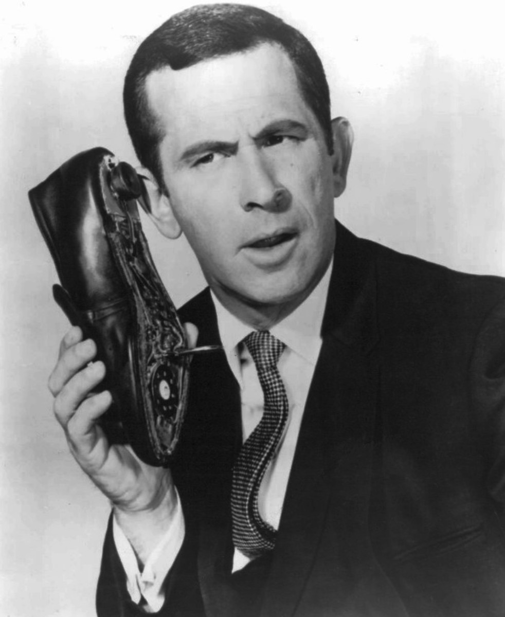 "Maxwell Smart, secret agent in the TV show, ""Get Smart,"" using his signature shoe phone. There is no evidence that real spies used shoe phones. but the shoe below did have a secret purpose."