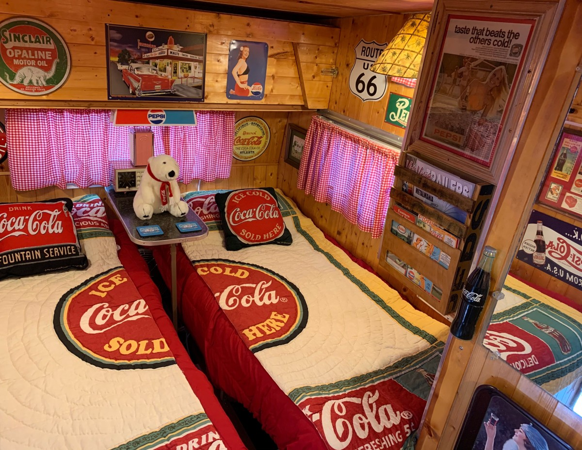 A house divided means a HOUSE DIVIDED! Here a Coca-Cola logo quilt is split in half for for the camper's twin beds covers, with the Coca half of the logo on the left side and the Cola half of the logo on the right side.