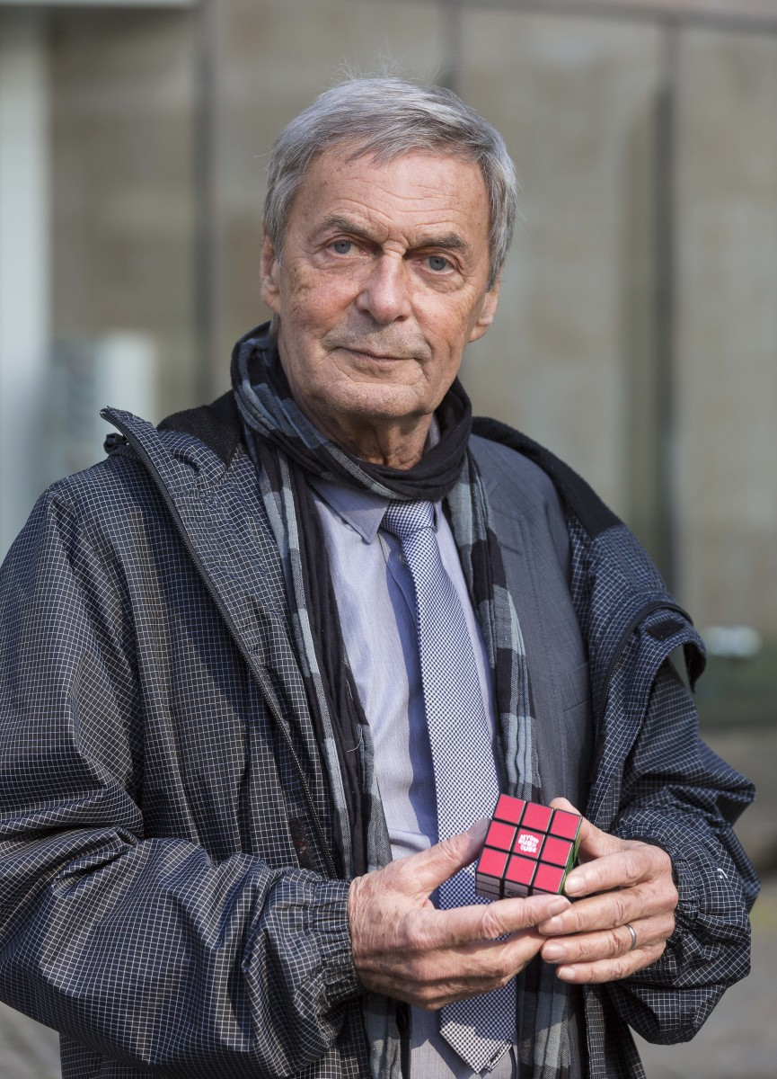 Hungarian inventor, architect and professor of architecture Erno RUBIK is posing with a Rubik's Cube after an event for the 40th anniversary of the creation.