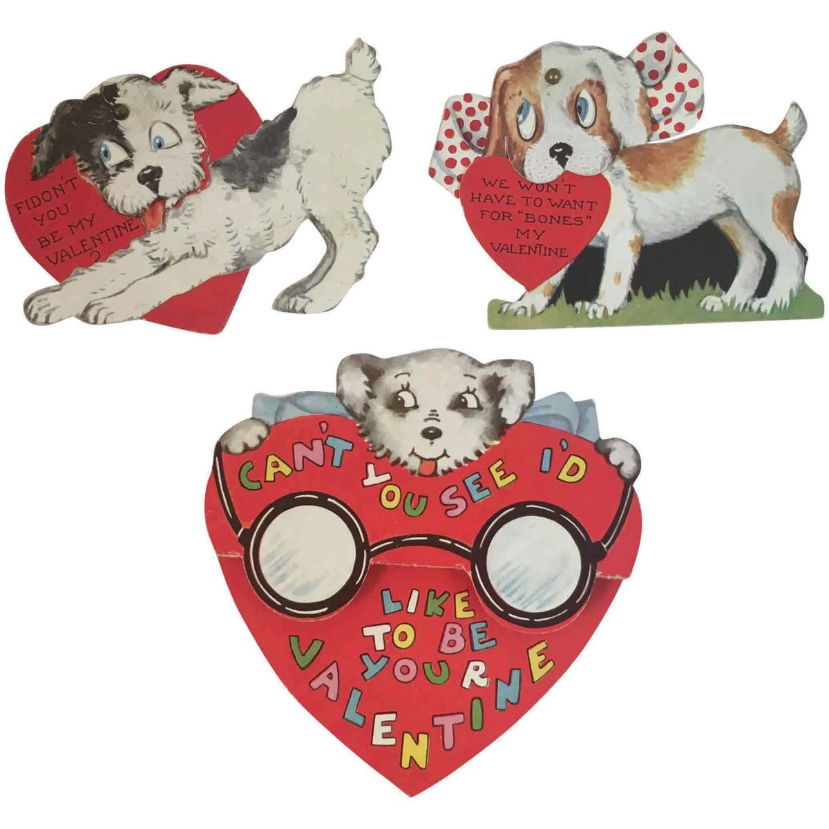 This is a cute group of dog-themed vintage valentines. The two smaller ones at the top are mechanical with movable pieces that make the eyes move. The larger one with the heart is somewhat 3D, with the eyeglasses popping up slightly in the way that it's folded; $12.