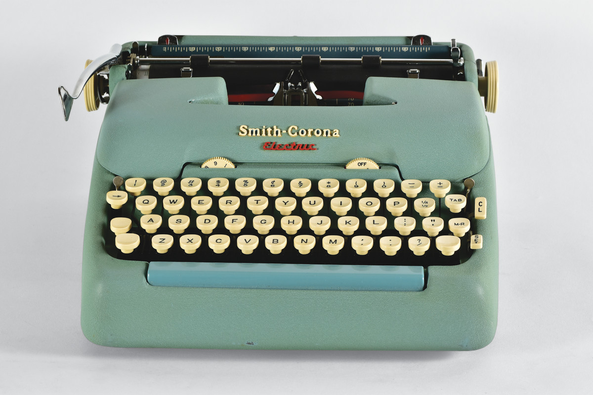 Smith-Corona Electric Portable typewriter, 1957, featured light touch and rapid speed, distinguishing it from its manual counterparts. It was a hit with users and came in blue, beige, pink and green models.