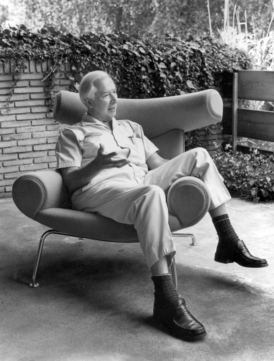 Hans Jorgen Wegner, a major force in the mid-century Danish furniture design movement, relaxes in one of his most iconic creations, the Ox chair.