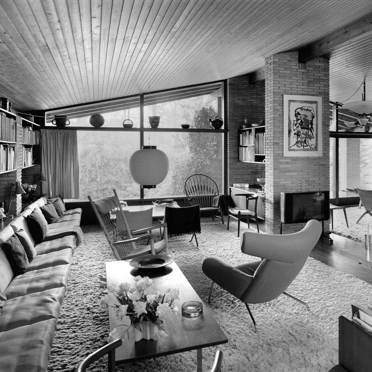 Hans Wegner's living room filled with mid-century wonders that helped to make his design work celebrated worldwide.