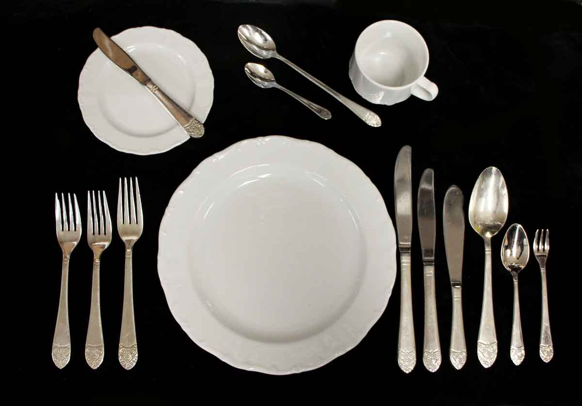 A 12-piece formal place setting salvaged from the Waldorf Astoria. The silverware pieces are made of silver plating over steel and include a dinner knife, salad knife, fish knife, butter knife, tablespoon, teaspoon, iced tea spoon, demitasse spoon, dinner fork, salad fork, oyster fork and fish fork.