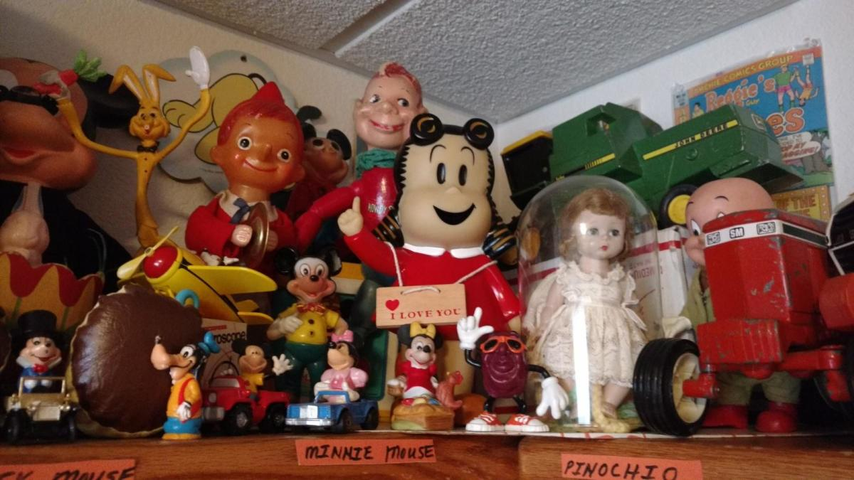 Some of Mueller's character dolls including Howdy Doody, Little Lulu and Mickey and Minnie Mouse.