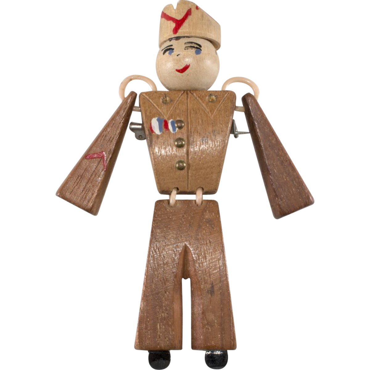 "Wooden ""Sweetheart""  soldier brooch, early 1940s."