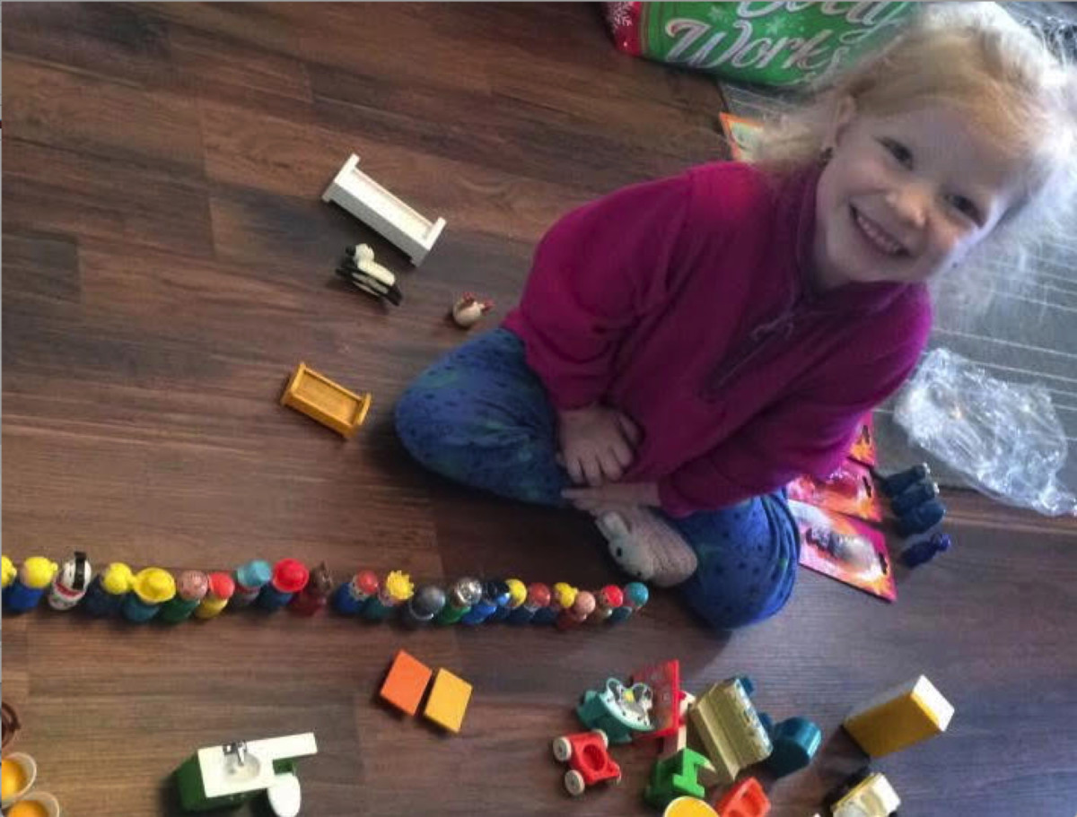 Rockwell's daughter, Charlotte, loves playing with vintage Fisher-Price toys.