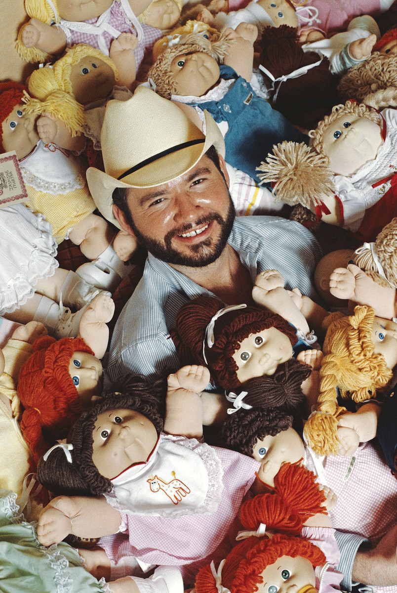 Cabbage Patch Doll creator Xavier Roberts with a group of Cabbage Patch Kids in 1983. Coleco sold more than 3 million dolls by the end of 1983.