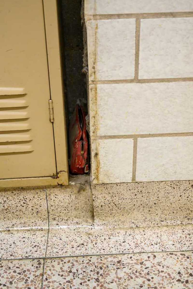Lost since 1957, the purse had fallen between a school locker and wall.