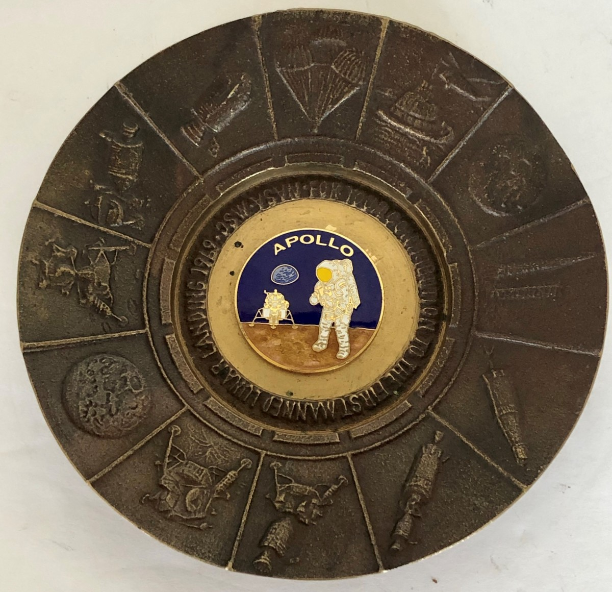 This brass dish was given only to NASA employees in 1969 to celebrate the successful manned moon landing. It was never commercially available. Bradley paid $1 for it and sold it at auction for $225. Score!