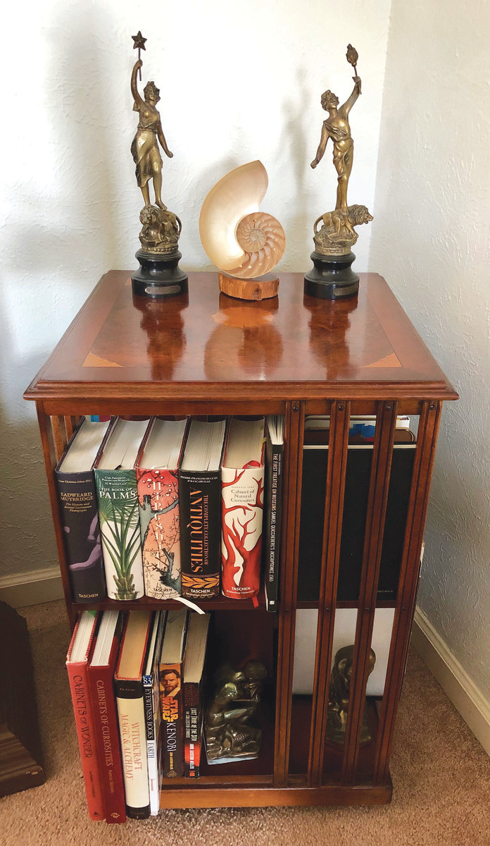 My absolute favorite thrift store find is this beautiful revolving bookcase I pounced on for $25. It has inlaid veneer and I like the classy look and how well it holds my favorite books. I've seen similar bookcases offered at retail between $800 and $1,200, but no amount of money will make me part with this beauty.