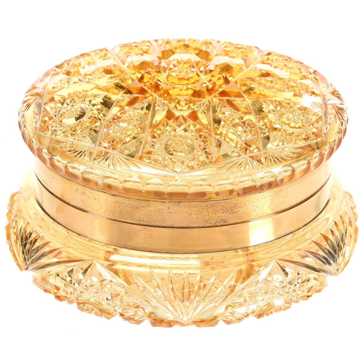 "One of the expected star lots is this ABCG round dresser box in a solid gold color with gilt metal fittings, attributed to Union Cut Glass and purchased from the Julian De Cordova Museum in Lincoln, Mass, 3 -1/2"" x 6-1/4""."