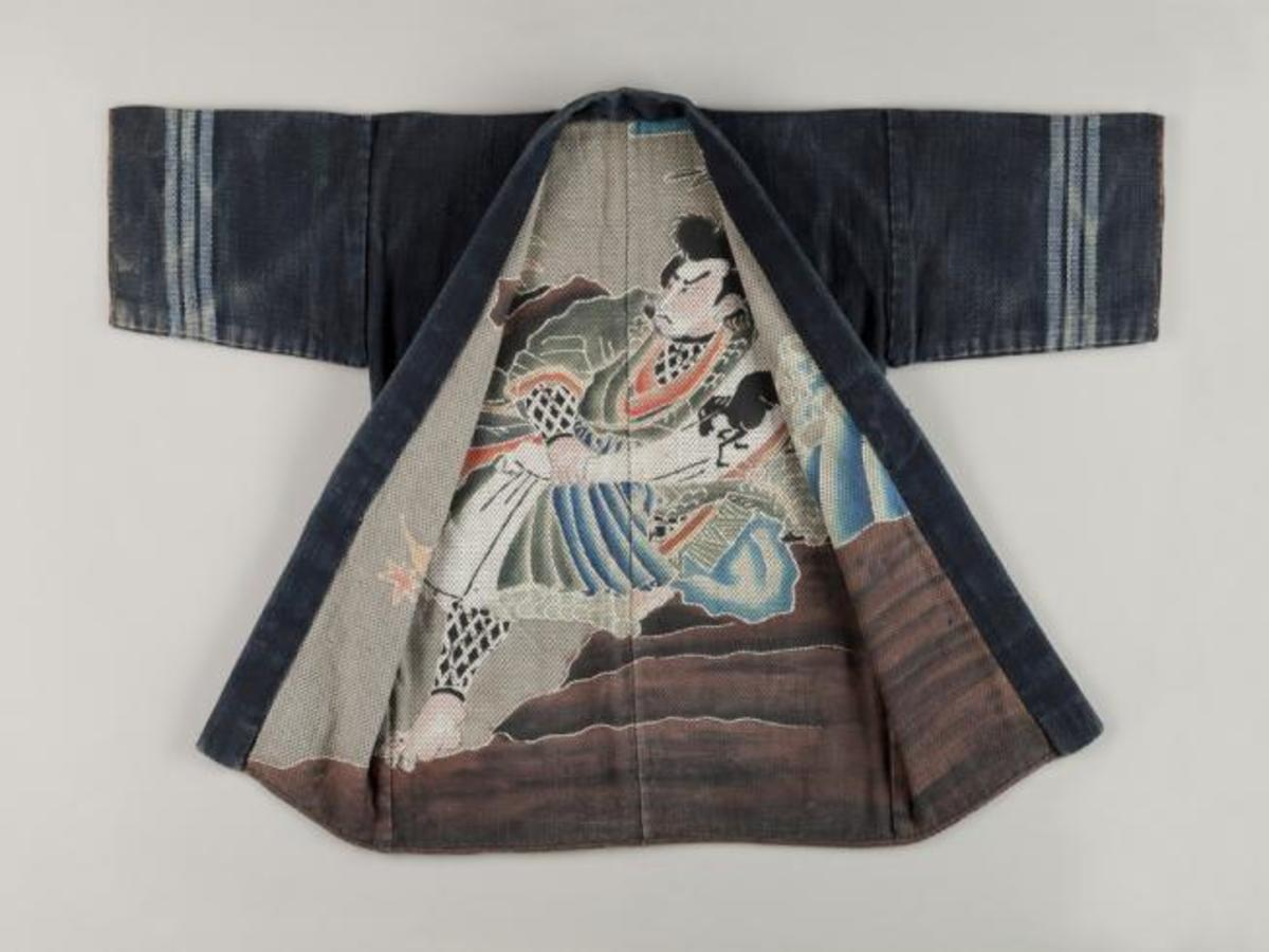 The interior of this late 19th or early 20th century coat features Jiraiya, a figure of Japanese folklore whose adventures were first published in 1806 in The Tale of Jiraiya. Jiraiya is known for his ability to morph into a giant toad, and as shown below, the wizard is depicted encountering a toad that he has summoned using his scroll. Denver Art Museum/public domain
