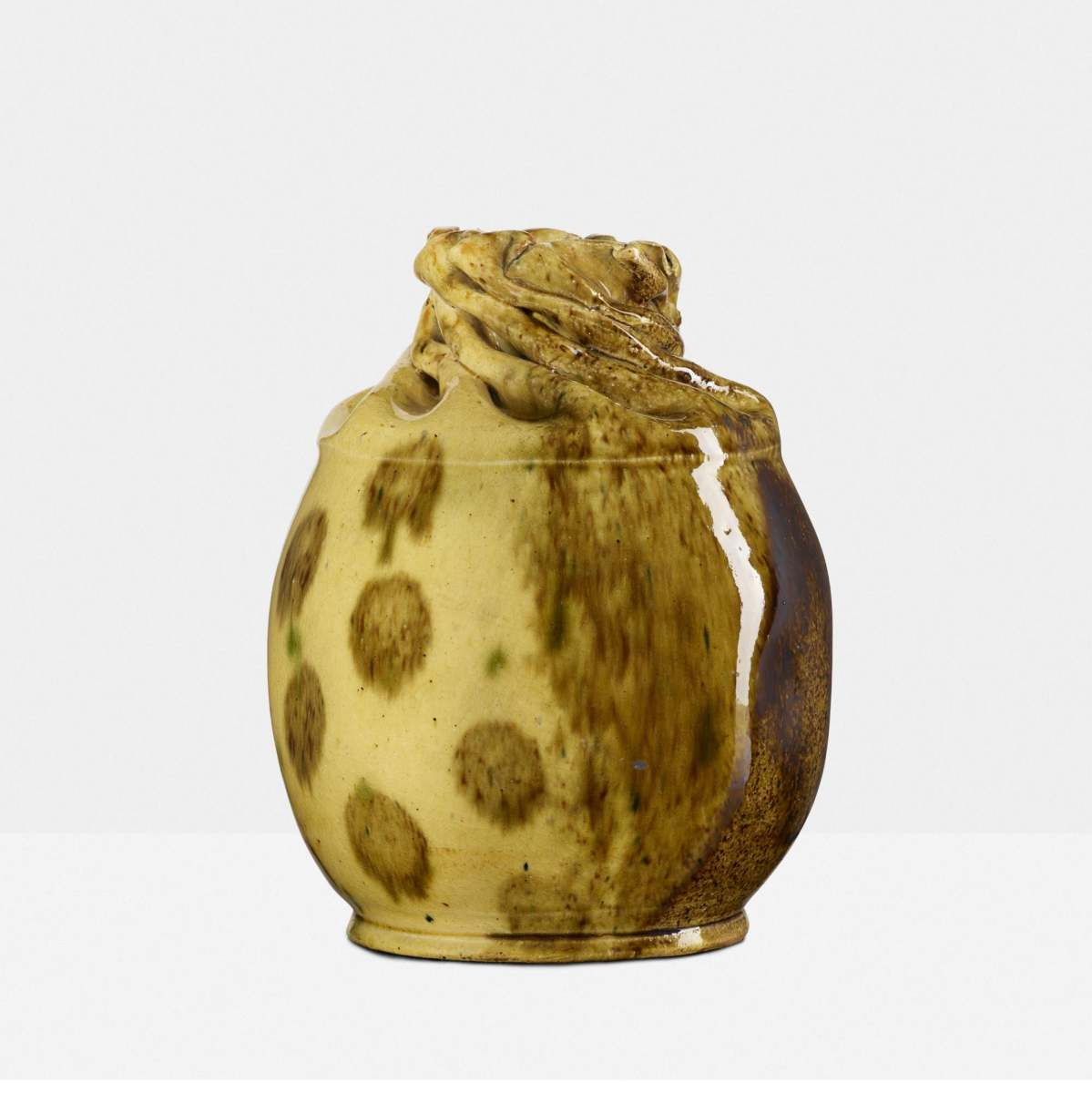"Large, two-sided vase, 1897-1900, ruffled rim and polka dots on one side and an ochre glaze on the other, 6"" h × 4-1/2"" dia; sold at Rago for $20,000."