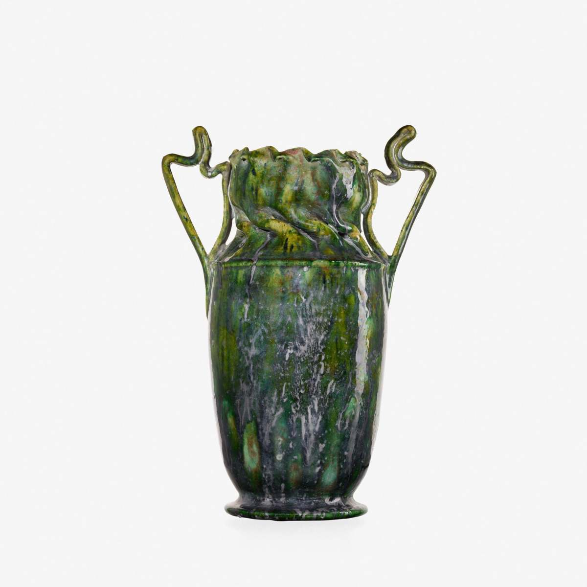 "Exceptional, large vase, 1897-1900, with a deep in-body twist, ribbon handles, and green and gunmetal sponged-on glaze, 9-3/4"" h × 7"" w × 4"" d; sold at Rago for $40,000. From the collection of James Carpenter."