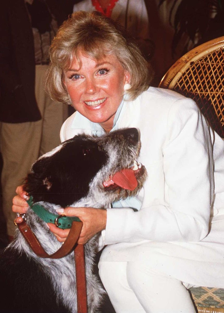 """Doris Day loved animals. She once said, """"They give us unconditional love and ask very little in return. I've never met an animal I didn't like, and I can't say the same thing about people."""" Here she is in 1985 with one of her beloved dogs."""