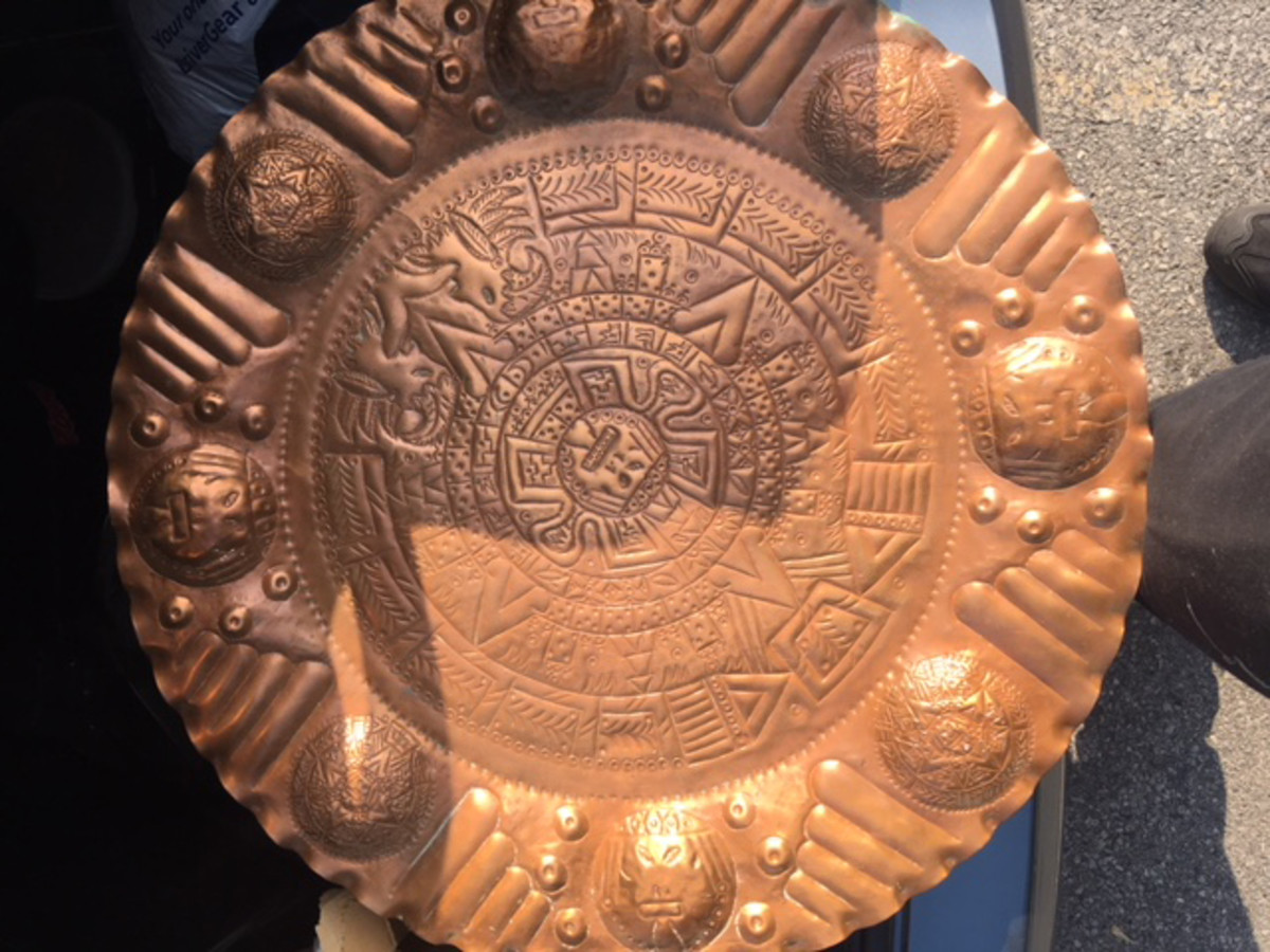 Aztec hammered copper serving plate.