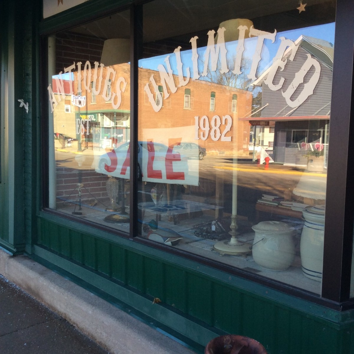 The outside window of the Cuba City, Wis., antiques mall Mullikin has her business in. It's a small town, but with five antiques stores in the town now, it's a destination for antiques shoppers, Mullikin said.