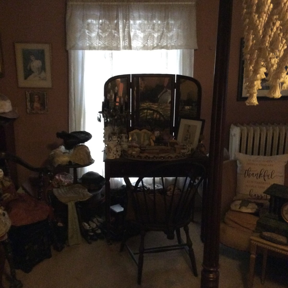 An antique vanity and trinkets set up in Mullikin's bedroom.