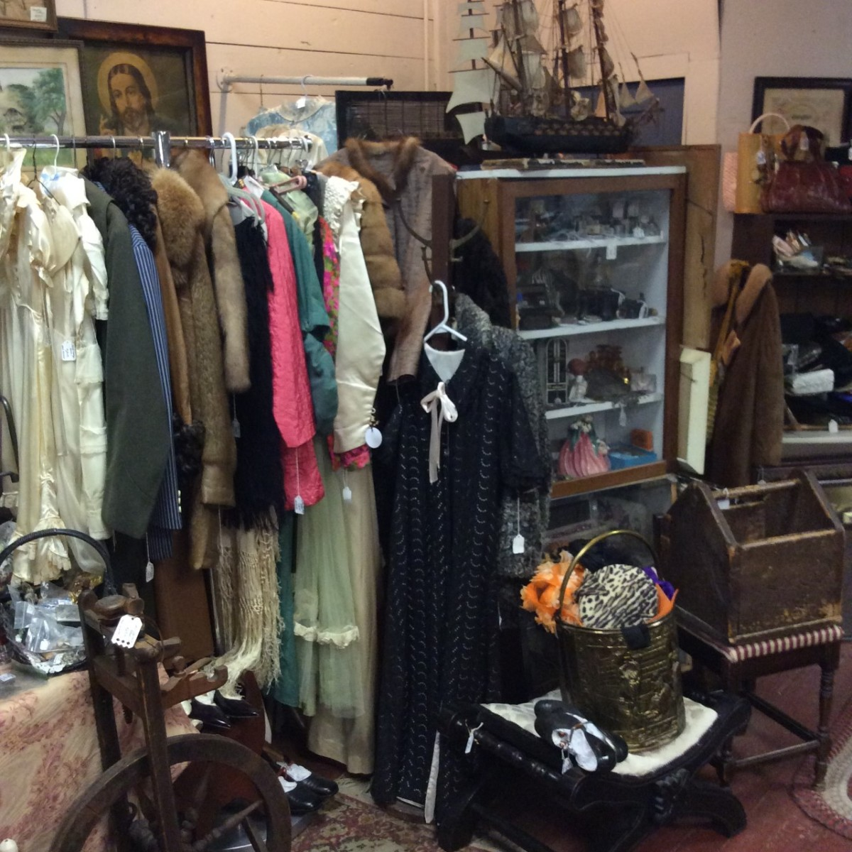 Pictured above and below is some of the antique and vintage clothing,  and many other items, in Mullikin's shop.