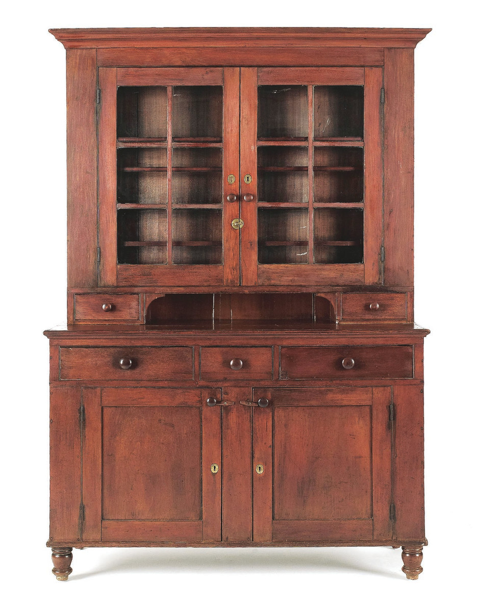 Care must be taken to preserve this Pennsylvania two-piece walnut Dutch cupboard, circa 1820.