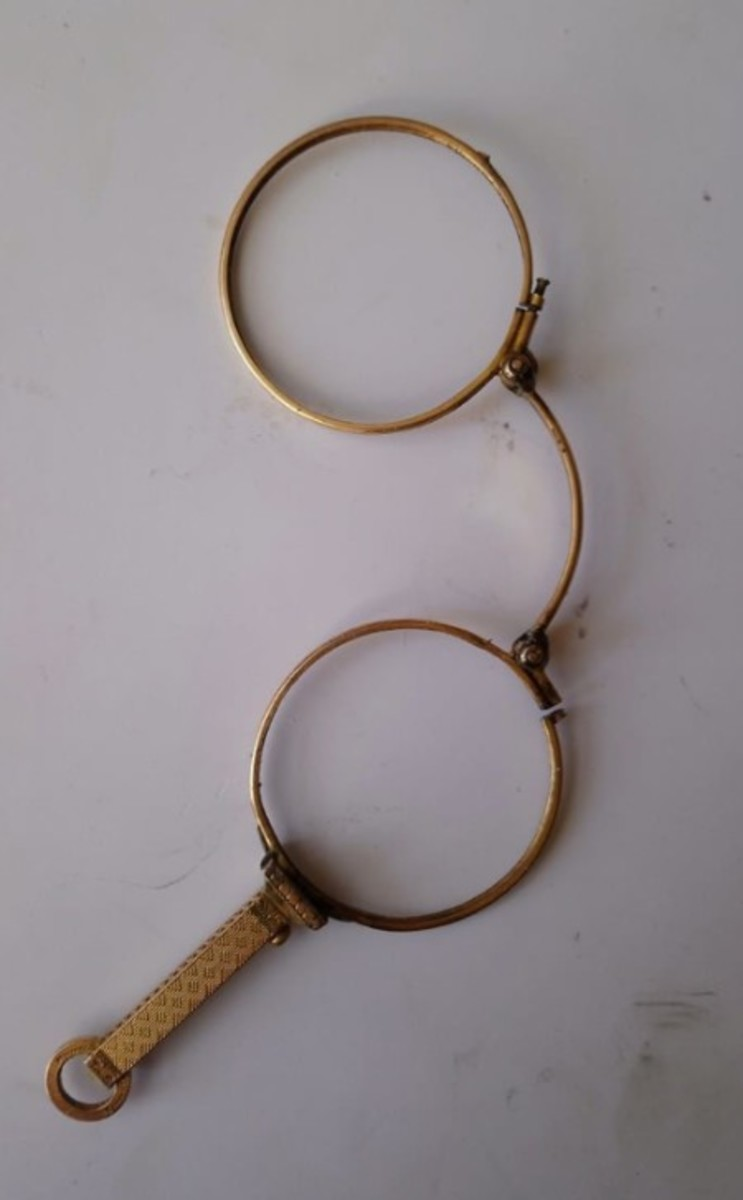 The lorgnette eyewear piece Mel Wartenberg is working on. She said a piece like this may require 3-7 hours to repair, depending on the severity of the damage inside of it.