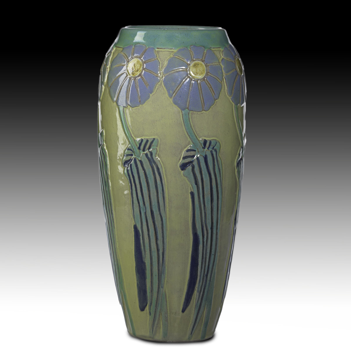 "Mary L. Yancey, Iowa State, Ames, Iowa, vase, 9-1/4"" x 5"", carved with blue daisies on yellow ground, 1920s."