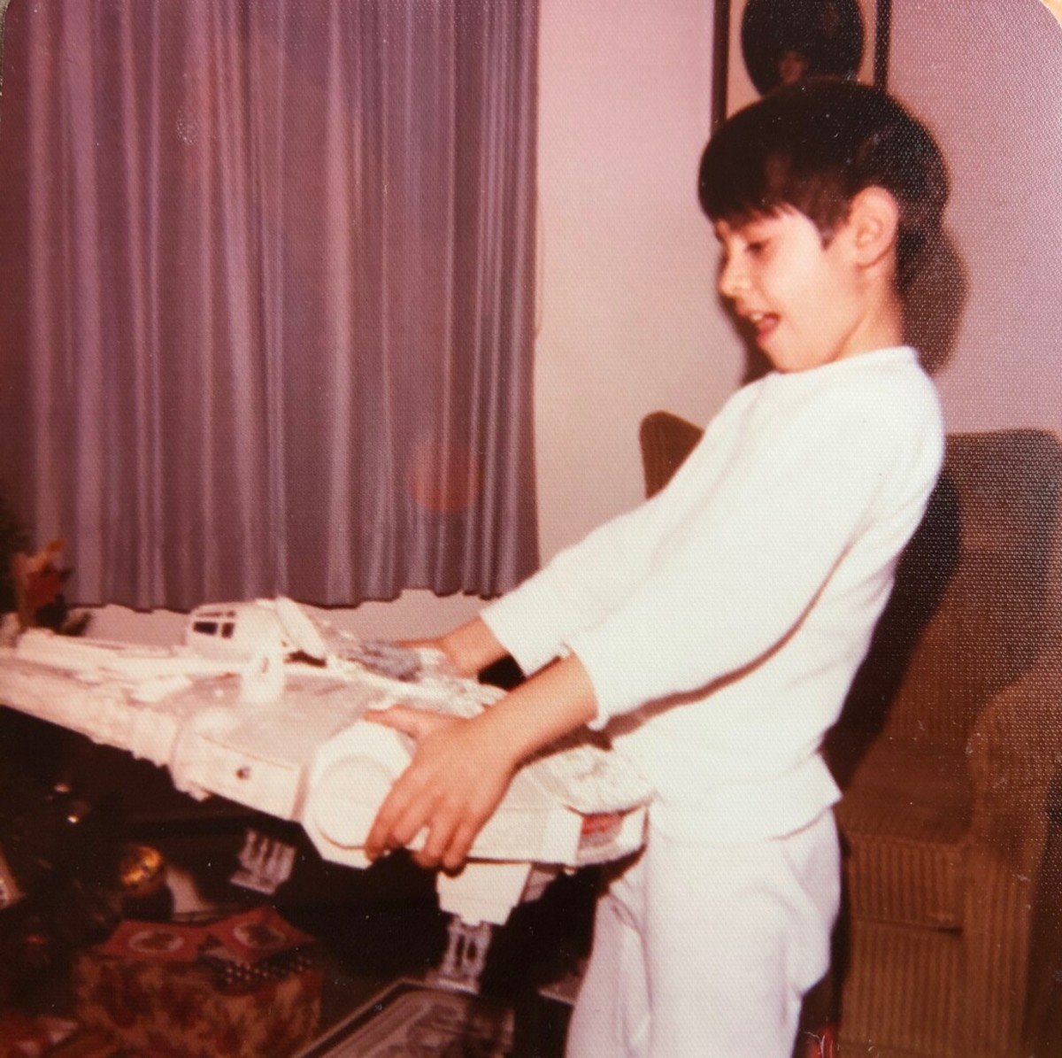 Mark Bellomo, 7, with his Star Wars Millennium Falcon on Christmas Day, 1978.