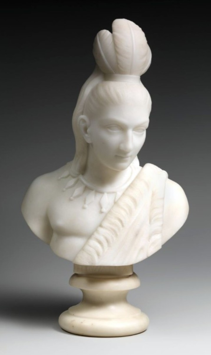 """Lewis' multiracial identity and gender were formative in her selection of subjects. Between 1866 and 1872, she completed a series of marble sculptures on the popular theme of Hiawatha (shown here) and Minnehaha (shown below), drawn from Henry Wadsworth Longfellow's epic poem, """"The Song of Hiawatha"""" (1855). These cabinet-sized busts represent the star-crossed lovers from once-warring nations and blend an idealized treatment of form with Native American dress and accessories."""