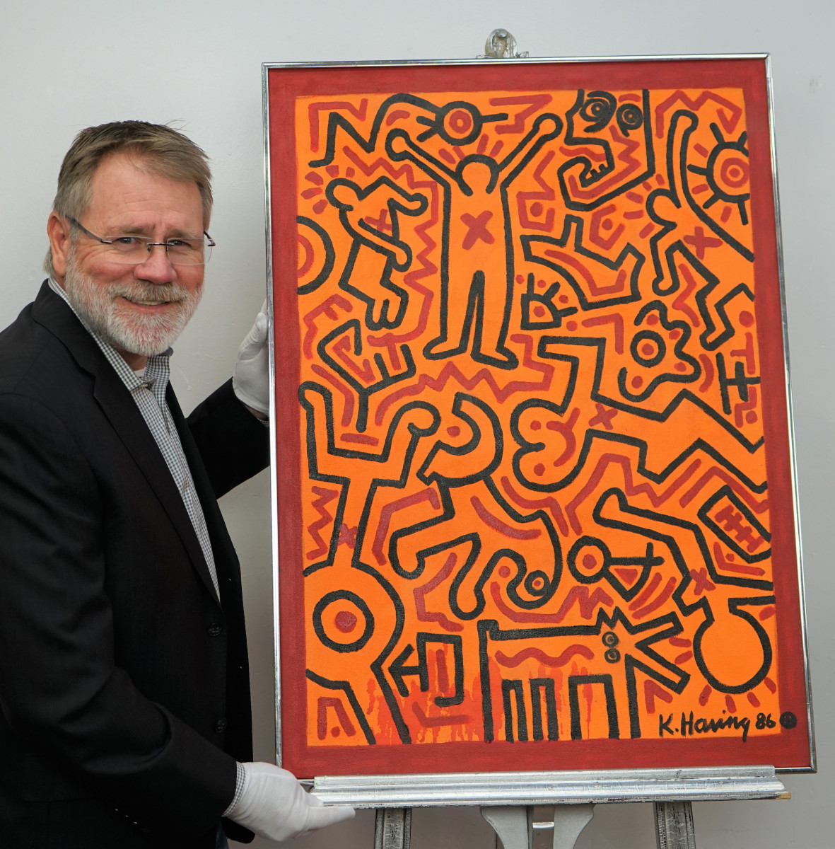 Erik Hoyer, CEO of EJ's Auction & Appraisal, with Keith Haring's recently discovered painting.