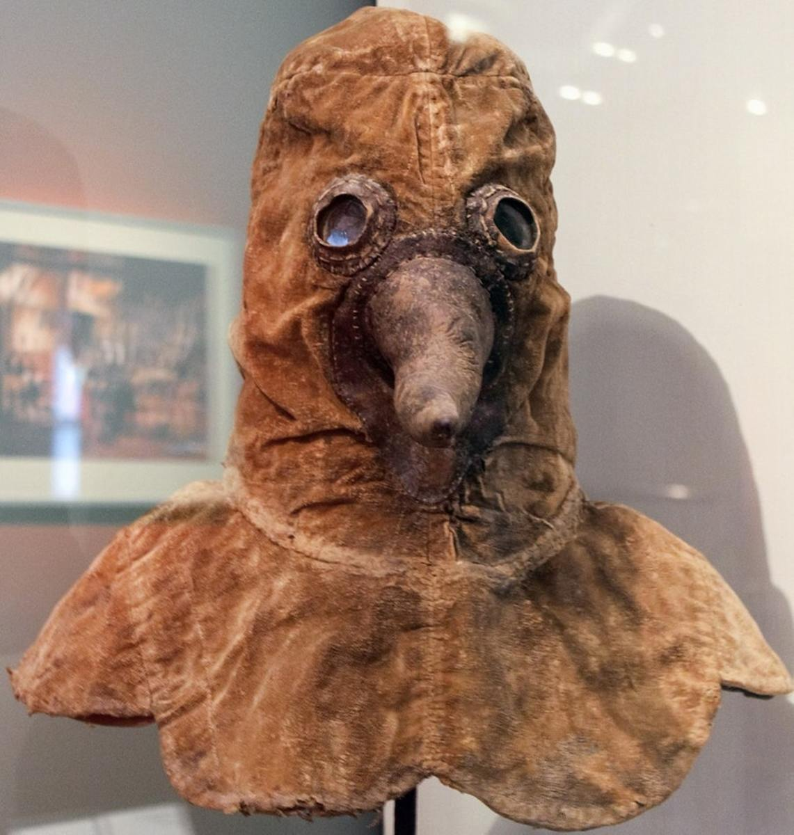A 17th-century plague doctor mask from Austria or Germany on display in Berlin's Deutsches Historisches Museum.