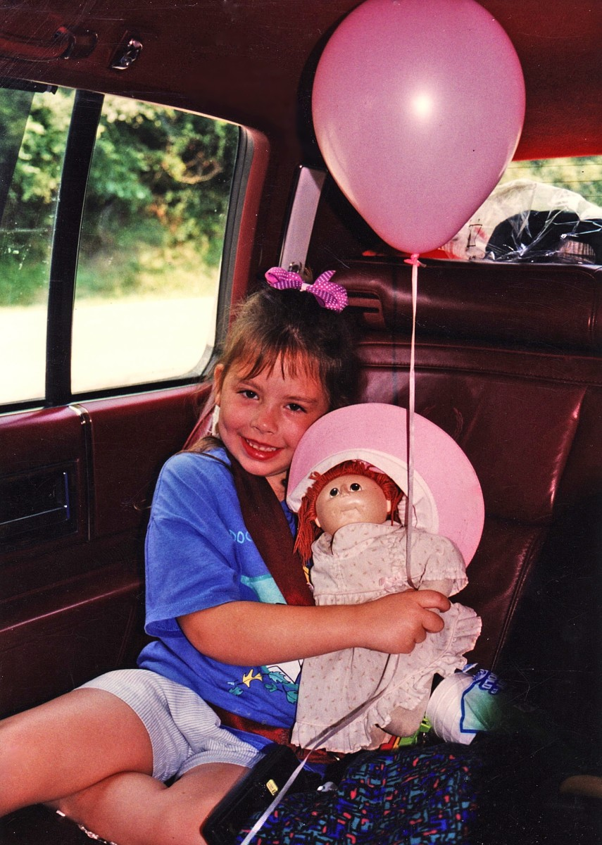 The author when she was 6 with her Cabbage Patch doll, Susie