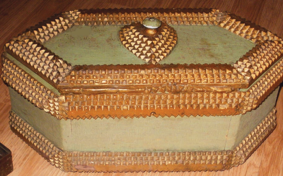 The author's great-grandfather, Jacob Buseman, made this wooden jewelry box for his wife, Martha. The box, trimmed with intricate carved diamond patterns, is an example of Tramp Art.