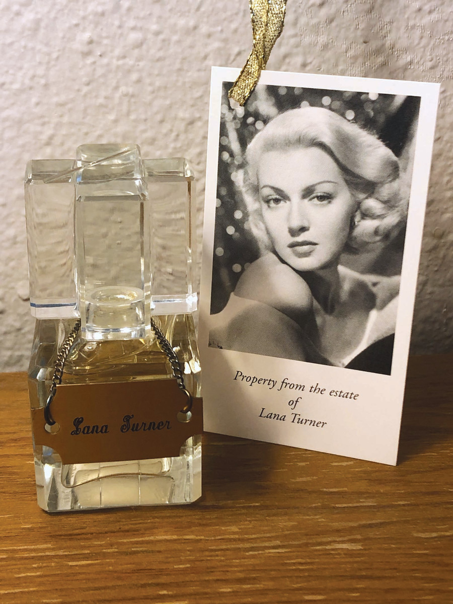 A small glass perfume bottle once owned by Lana Turner.