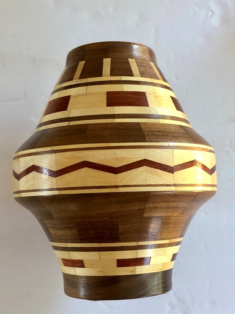 A 9-inch vessel of segmented turning made from 188 different pieces of wood by Gene Lee