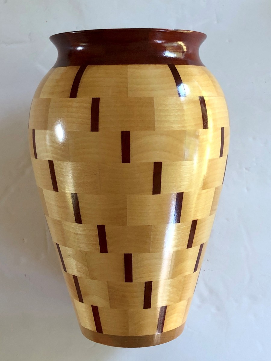 A 9-inch vase by Paul Thibodeau made of maple and mahogany.