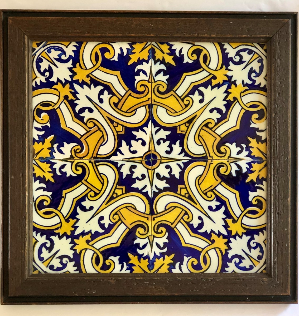 A framed group of 6- by 6-inch ceramic tiles depicting an Italian motif dating to the early 20th century.