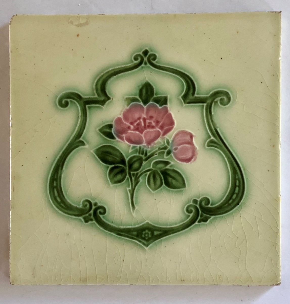 A 6- by 6-inch Art Nouveau ceramic by T. A. Simpson & Co. in England tile came with a smile and a story to share.