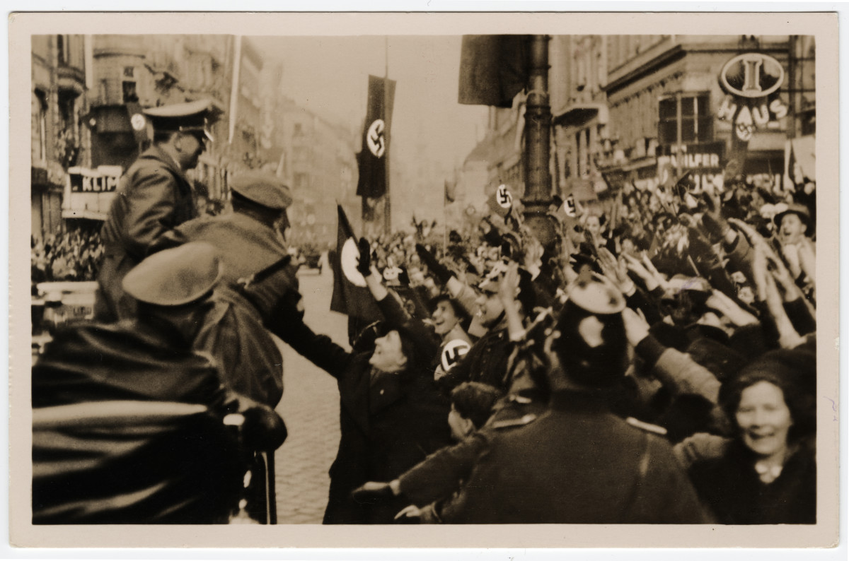 A postcard capturing the entry of Adolf Hitler into Vienna in 1938.