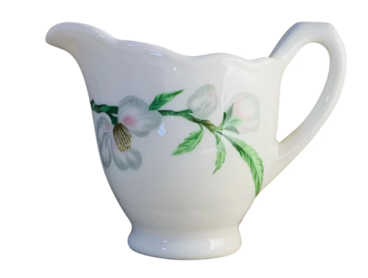 """A Syracuse China creamer with a Dogwood pattern, 3-1/2"""" h, made in 1956, as indicated by the Syracuse stamp on the bottom, as shown below; $12."""