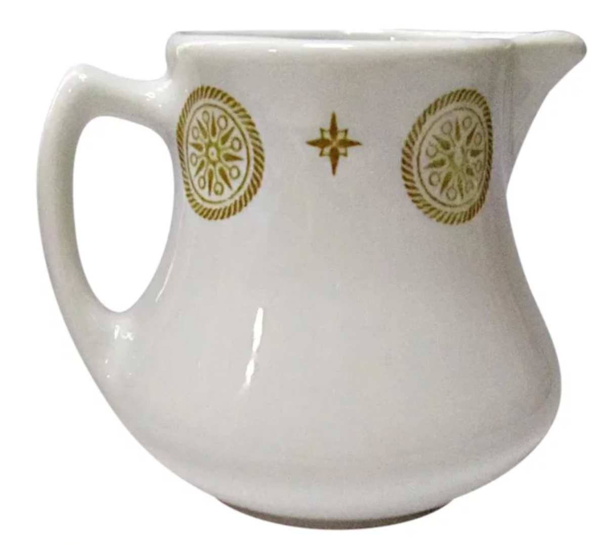 """A vintage cream pitcher by Shenango, with a gold medallion and star pattern. This pattern was popular and made for many years. The size is approximately 3-1/4"""" h x 3-1/2"""" w; $14."""