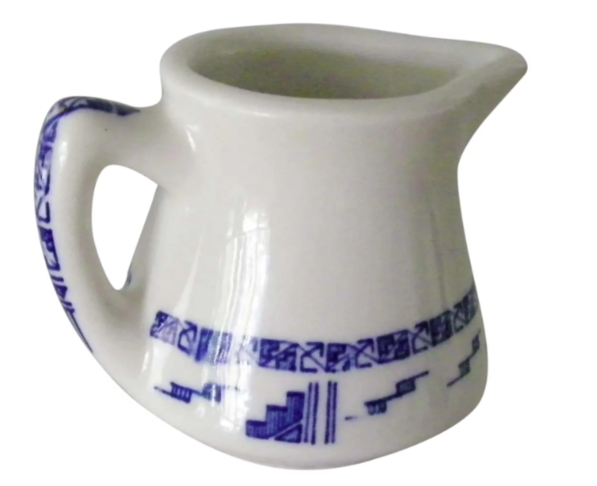 """Wallace China creamer pitcher with an Aztec 2 pattern in blue; the Aztec pattern by Wallace was in several colors. The bottom is marked """"Wallace China, 4L, Los Angeles, Calif.,"""" 3-1/2"""" spout to handle and stands 2-1/2"""" h; $16."""