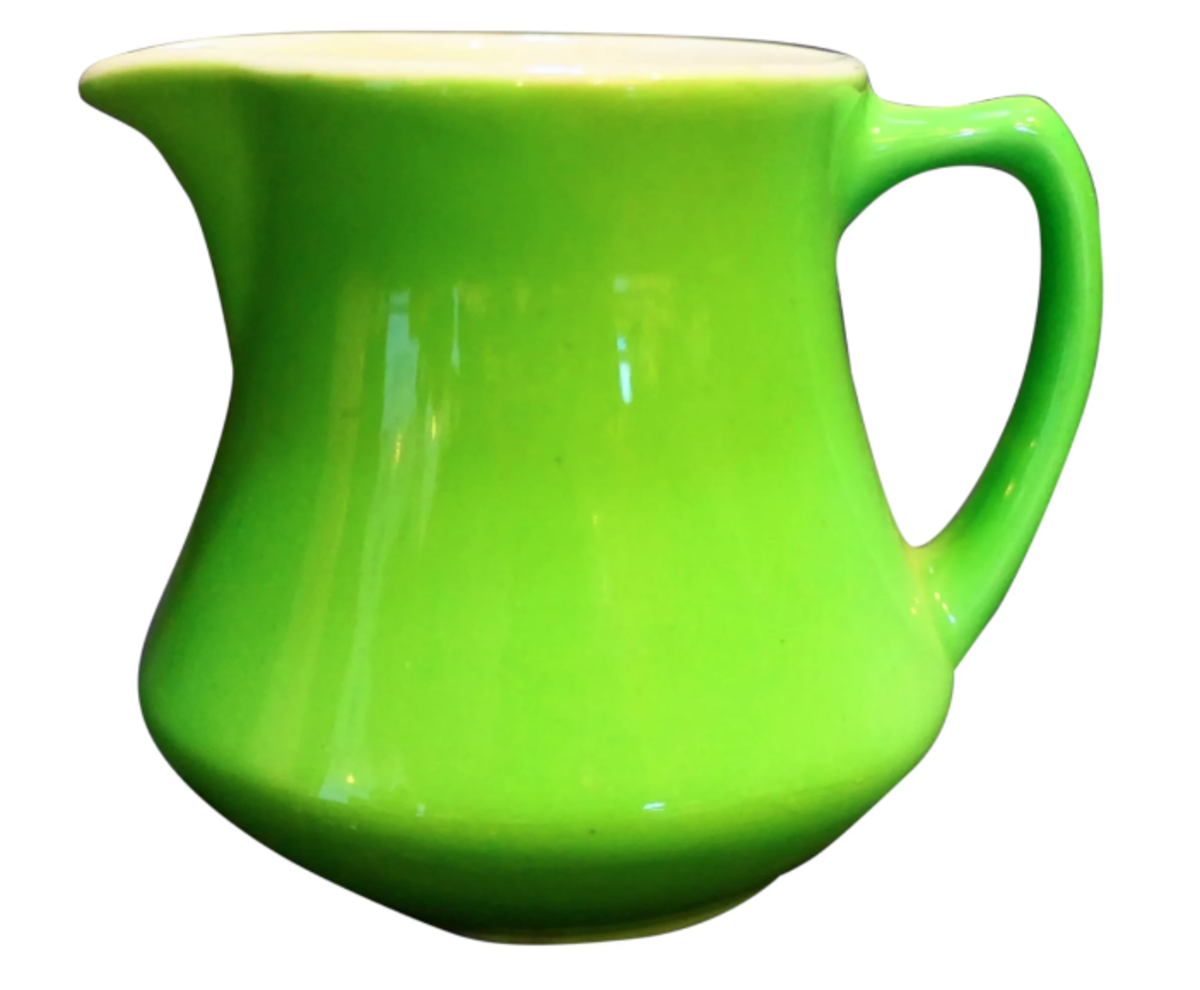"""A Syracuse creamer in bright, solid lime green. The creamer is marked Syracuse China USA on the base, as shown below, 3-1/8"""" h; $20."""