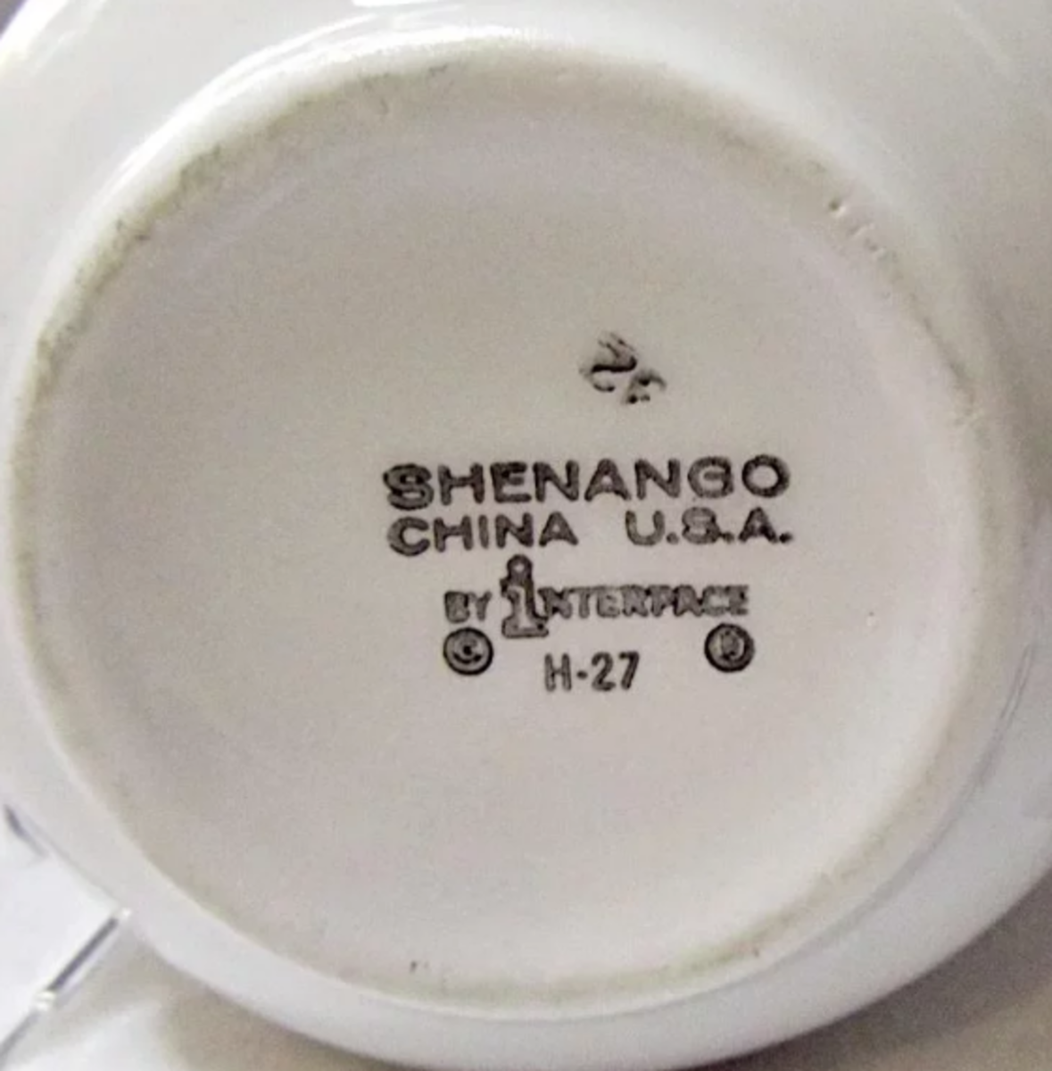 The date code of H-27 on the bottom of the cream pitcher above indicates that it was made during the last six months of 1969.