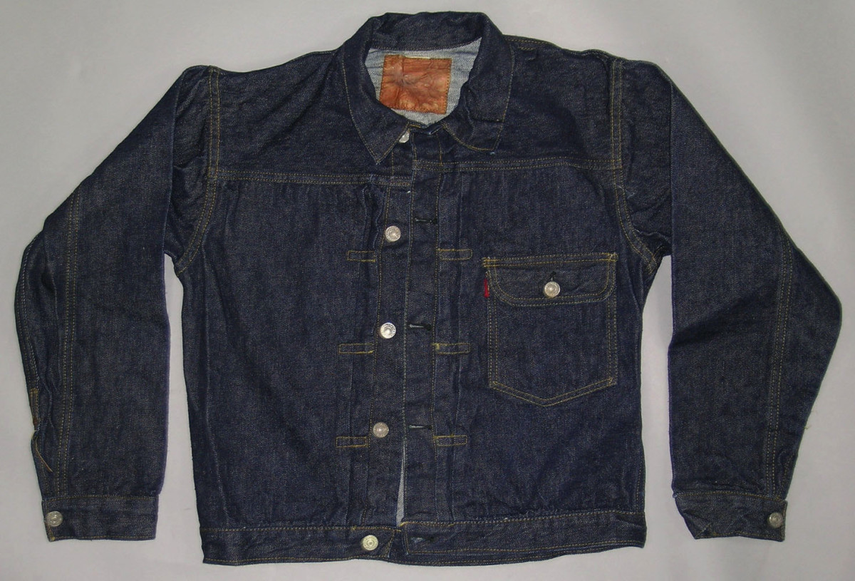 "A 1940s Levis 506XX denim jacket, metal cinch back with pin teeth, red tag on breast pocket with a large ""E,"" metal buttons marked ""Levi Strauss & CO S.F. CAL""; estimate: $6,000-$8,000."