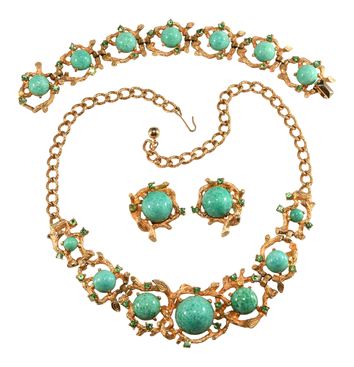 Unmarked costume jewelry set copying a Boucher design.