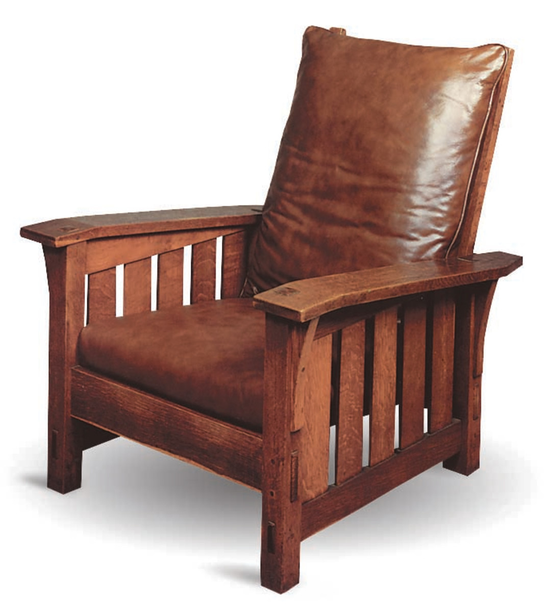 Leopold Stickley's finest tribute to William Morris, the leader and champion of the English Arts & Crafts Movement, this chair features long graceful bowed arms supported by elongated corbels, slatted sides, and adjustable back.