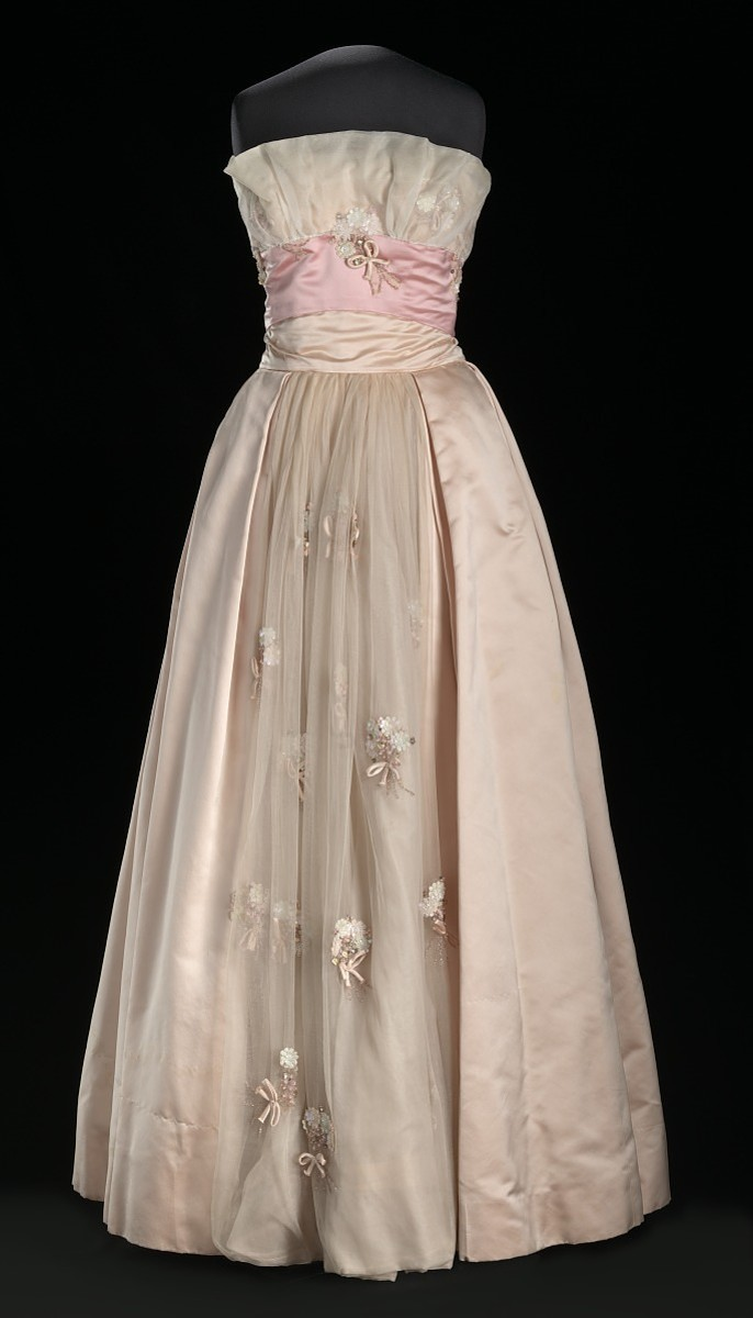 A pink satin and organza dress designed by Ann Lowe in 1959 and worn by Patricia Schieffer.