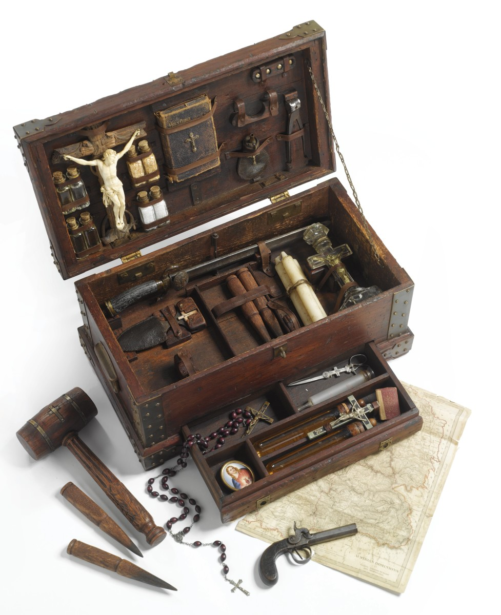 "Sotheby's sold this extensive vampire killing kit in 2011 for $25,000: Continental, circa 1900s and later, including 32 articles, some associated, a carved ivory and black forest lindenwood crucifix, vials with garlic, salt and ""holy water,"" a bible, a gun with a leather powder flask and silver bullets, a dagger, four stakes and a mallet, a molded glass cross-shaped candlestick, and an English map of Galizia, Eastern Hungary and Transylvania."