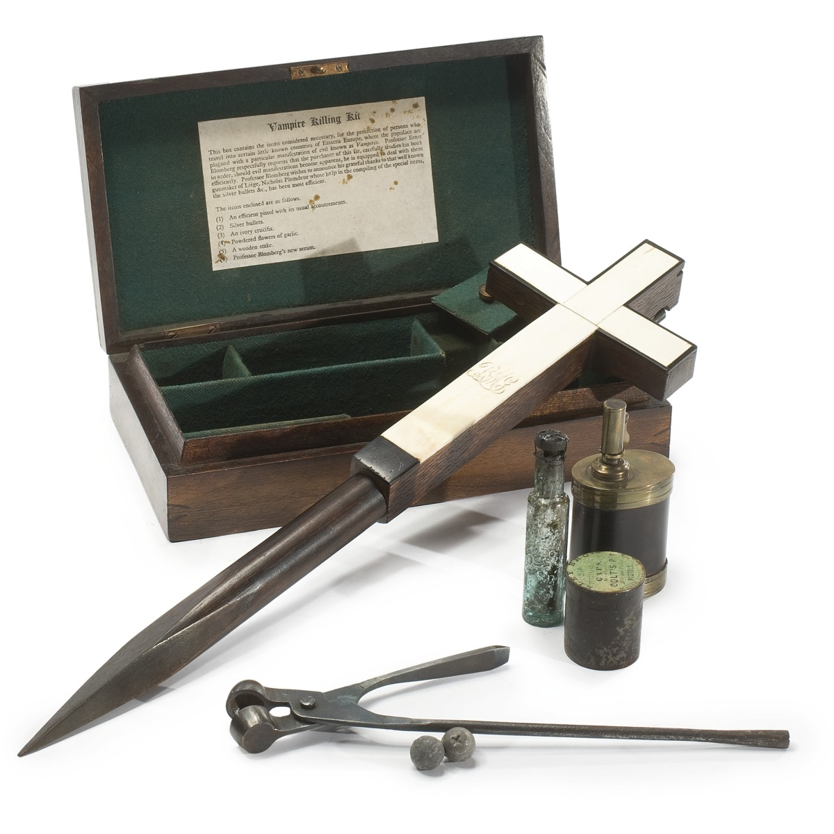 In 2011, Sotheby sold this kit for $17,500: a satiné wood, mahogany, ebony and ivory inlay kit, Continental, second half 19th century, containing an ivory and ebony inlay gun shaped crucifix, five silver bullets with struck hallmarks, a brass and patinated copper gun-powder flask, a sealed glass bottle, a bullet mold and a later colt's caps box by Eley Bro-London, the pistol-shaped crucifix with an engraved monogram BMG in cursive capital letters.